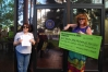 Protesters hand deliver symbolic big check from corporate American to McCain.