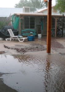 Soil contouring and other rain water harvesting techniques can solve residential flooding problems.