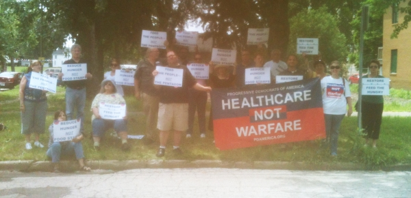 PDA members protest outside of Senator Dick Durbin's office in Illinois.
