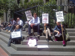 PDA members protested food stamp cuts outside of Senator Diane Feinstein's office.
