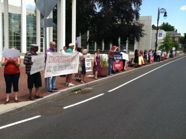PDA members protested food stamp cuts outside of Congressman Richard Neal's office in Springfield, Nass.