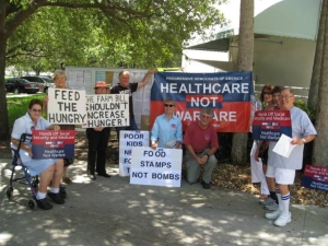 PDA members protested outside of the office of Congresswoman and DNC Chair Debbie Wasserman-Schultz.