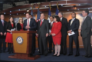 Arizona's Ann Kirkpatrick and Kyrsten Sinema (at left in matching black and red) are members of the United Solutions Caucus.