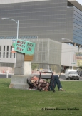 A homeless man sleeps in the shadow of corporate America.