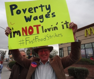 PDA Tucson's Jim Hannley, chair of the Economic and Social Justice Team, with PDA Tucson Chair Phil Lopes, behind him.
