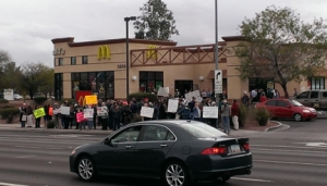 An estimated 80-100 protesters representing several liberal organizations protested low wages for fast food workers at McDonald's in midtown Tucson.