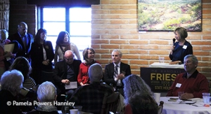Former Giffords' staffer Pam Simon introduces Friese, as Giffords, Kelly, Mach, Steele, and Carmons (R to L) look on.