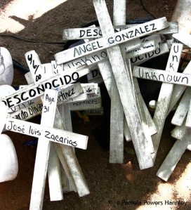 Crosses memorialize migrants who died crossing the Arizona desert in search of work and a new life.