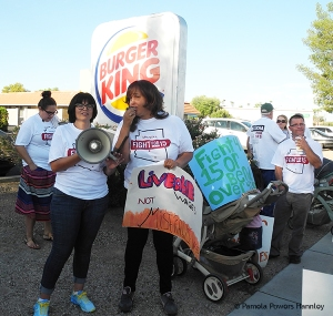 SEIU statewide leader Maya Castillo (left) with one of the striking Burger King workers.