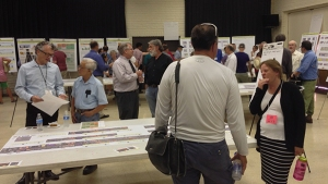 Hundreds of citizens attended a meeting in summer 2014 to review plans to widen Broadway Blvd.
