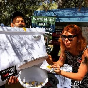 "Progressive activists at Tucson Earth Day say, ""Flush the TPP."""